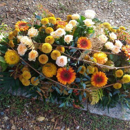 votre artisan fleuriste vous propose le bouquet : Dessus De Cercueil
