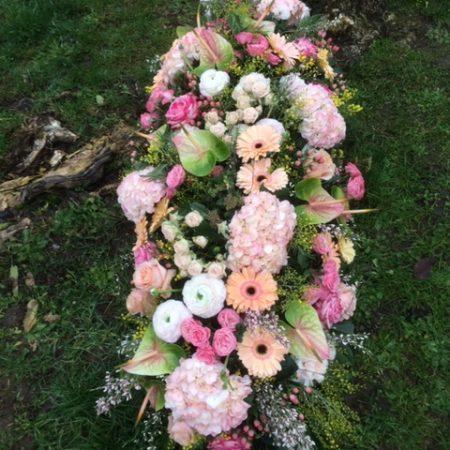votre artisan fleuriste vous propose le bouquet : Raquette Florale