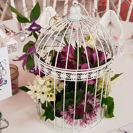 votre artisan fleuriste vous propose le bouquet : Cage fleurie