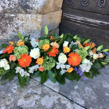 votre artisan fleuriste vous propose le bouquet : Raquette de fleurs