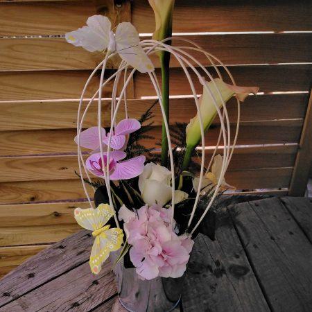 votre artisan fleuriste vous propose le bouquet : Cage aux papillons
