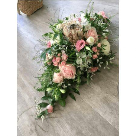 votre artisan fleuriste vous propose le bouquet : Raquette Deuil