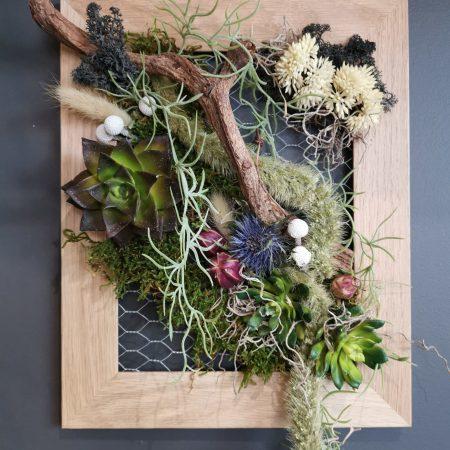 votre artisan fleuriste vous propose le bouquet : Cadre Végétale Intemporel