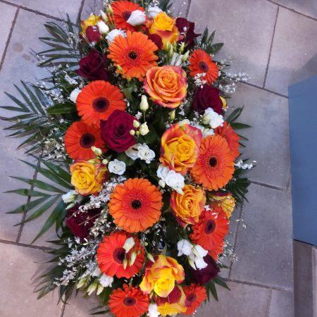 votre artisan fleuriste vous propose le bouquet : Deuil Raquette Colore