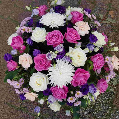 votre artisan fleuriste vous propose le bouquet : COUSSIN